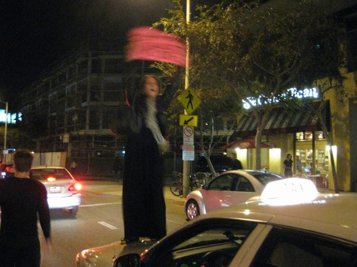 she asked if she could climb onto his hood, but the taxi driver thought she was asking for a ride and yelled at her to get down